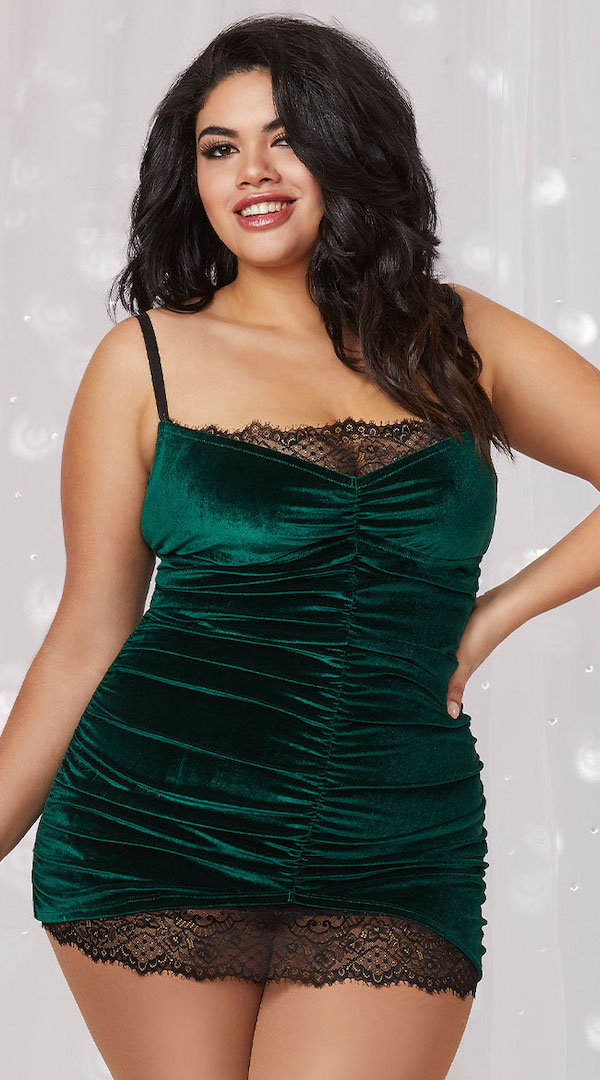 A model wearing plus-size green velvet lingerie slip.