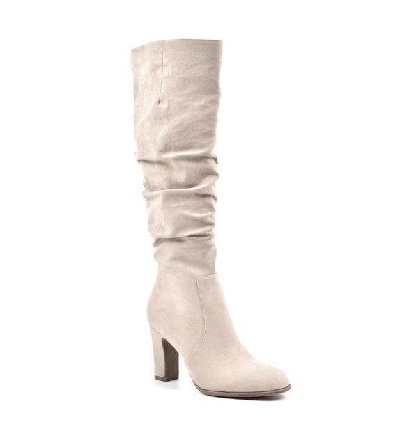 Wide-calf knee-high boots in cream.
