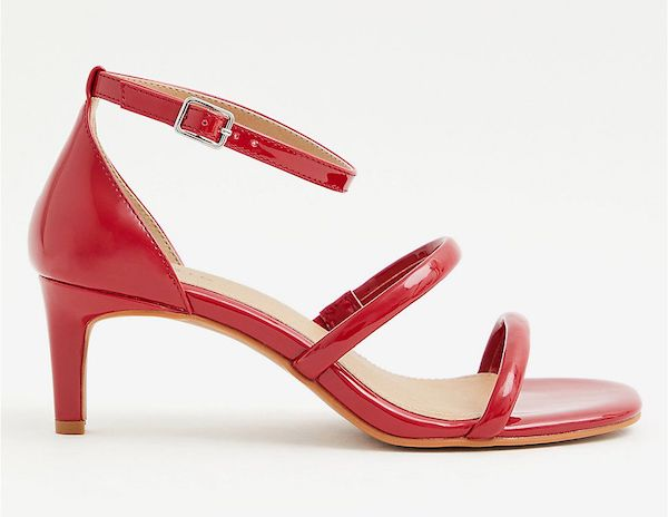 Red strappy wide-fit heels.