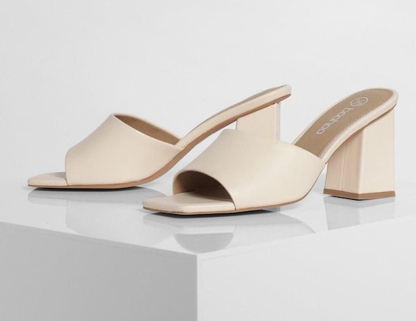 A pair of cream heeled mules.