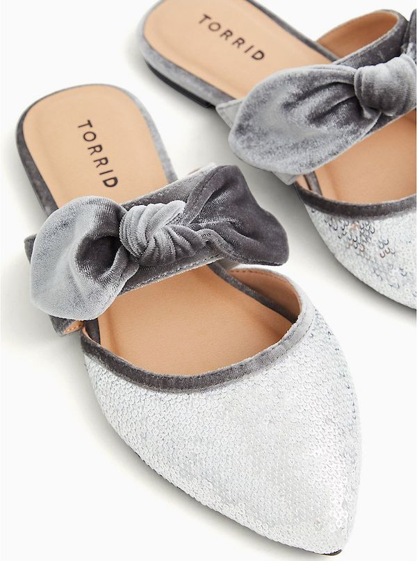 A pair of wide-fit mules in silver.