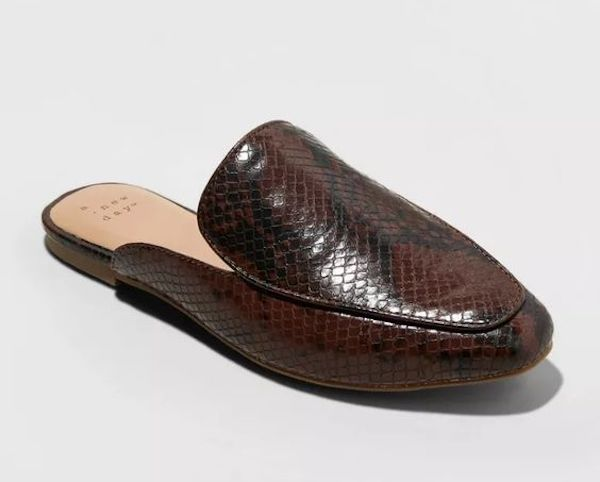 A pair of wide-fit mules in brown snake print.