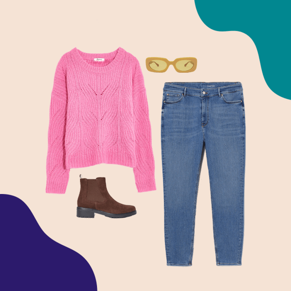 A pink sweater, mid-wash jeans, brown booties, and yellow sunglasses.