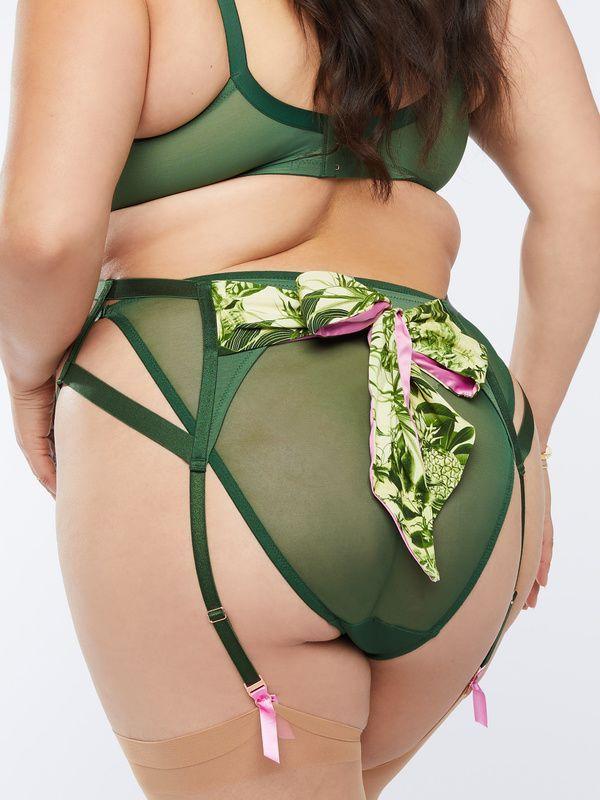 A model wearing a plus-size garter belt in green.