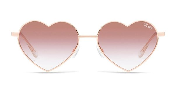 A pair of heart-shaped sunglasses in pink.