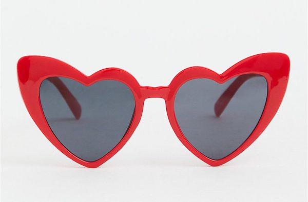A pair of heart-shaped sunglasses in red.