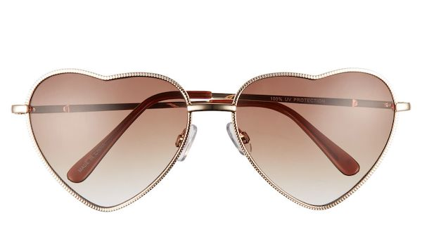 A pair of heart-shaped sunglasses in brown.