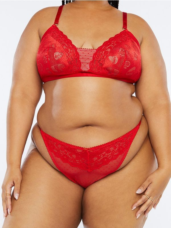 A model wearing a plus-size lace red thong.