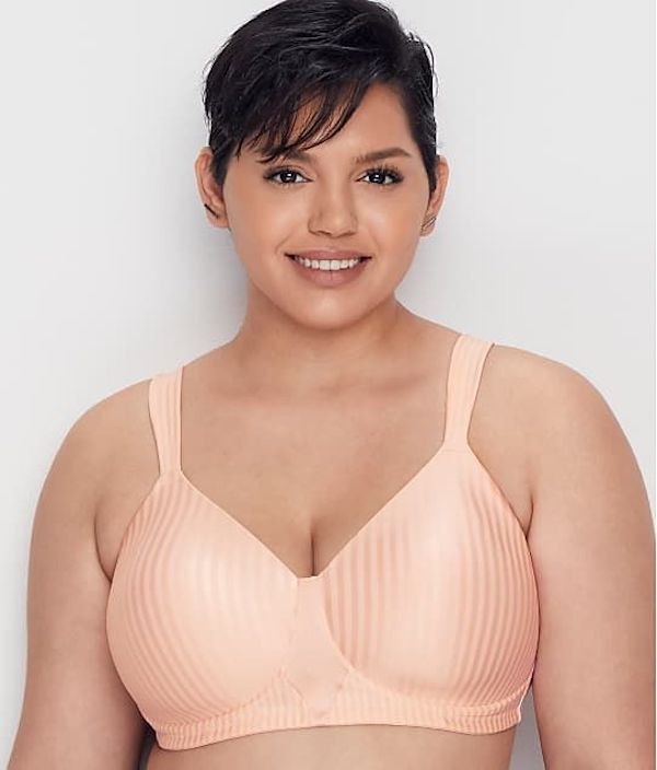 A model wearing a plus-size wire-free bra in light pink.