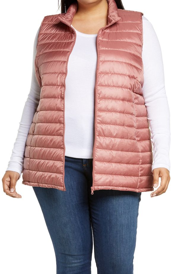 A model wearing a plus-size puffer vest in pink.
