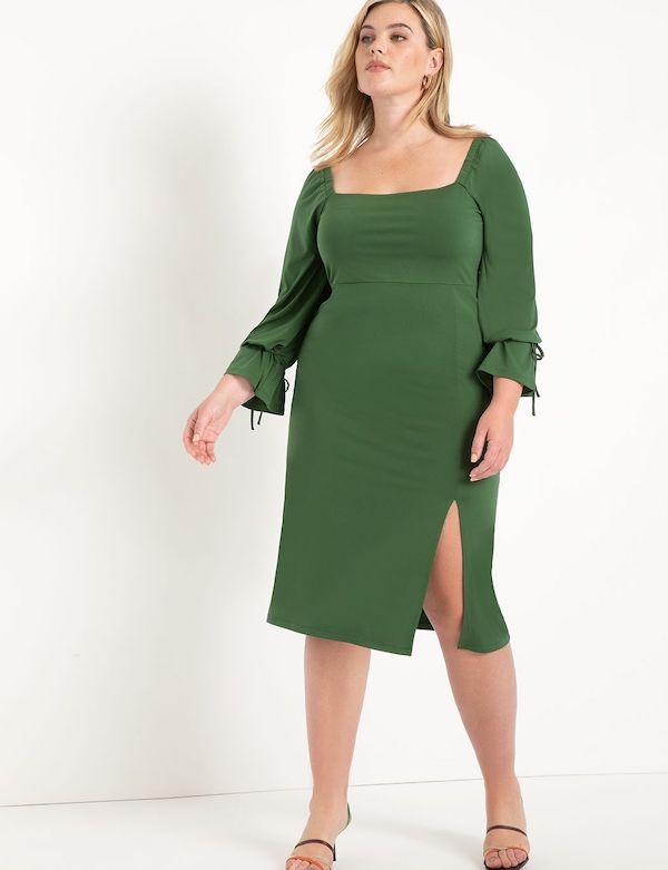 A model wearing a plus-size sexy winter dress in green.