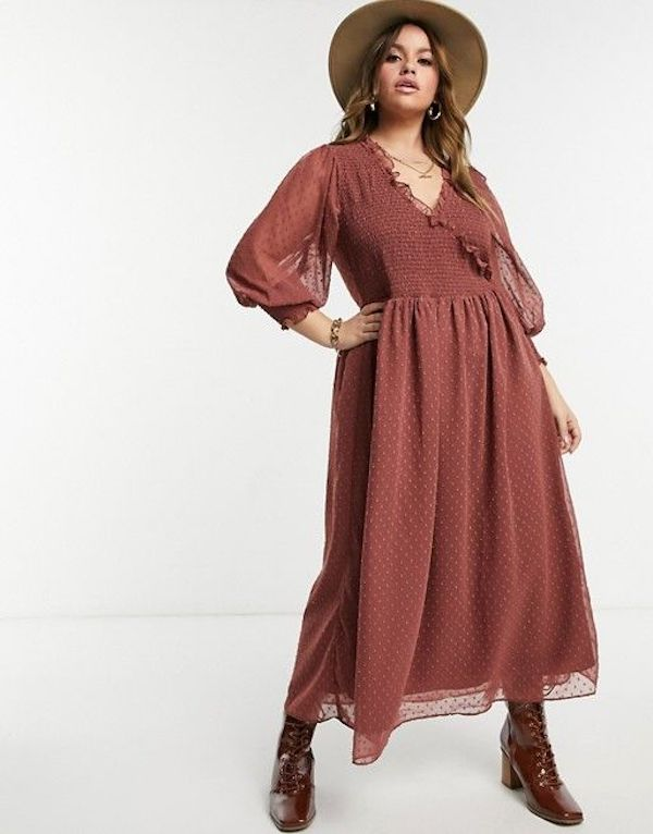 A model wearing a plus-size sexy winter dress in brown.