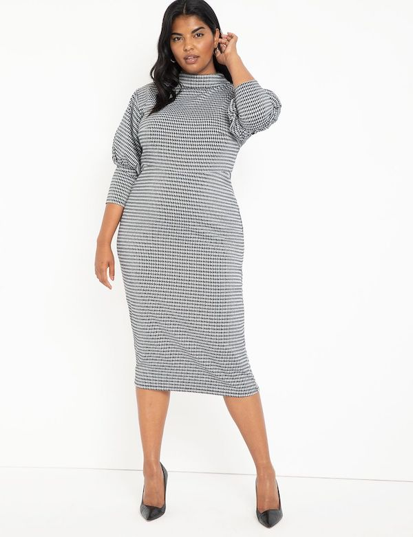 A model wearing a plus-size sexy winter dress in houndstooth.