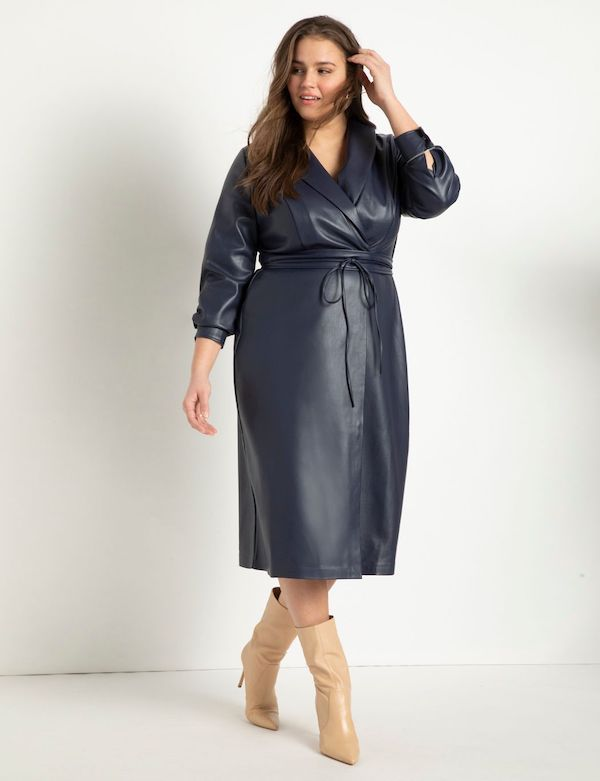 A model wearing a plus-size sexy winter dress in navy leather.