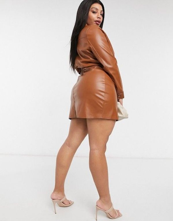 A model wearing a plus-size sexy winter dress in brown leather.