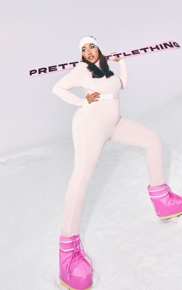 A model wearing a plus-size ski suit in pink.