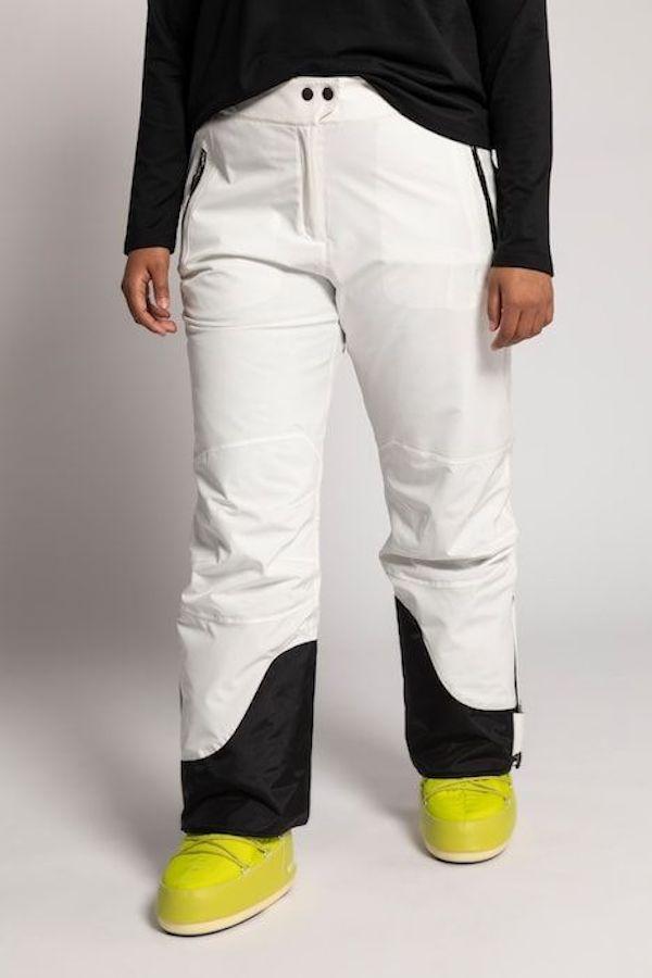 A model wearing a plus-size ski pants in white.