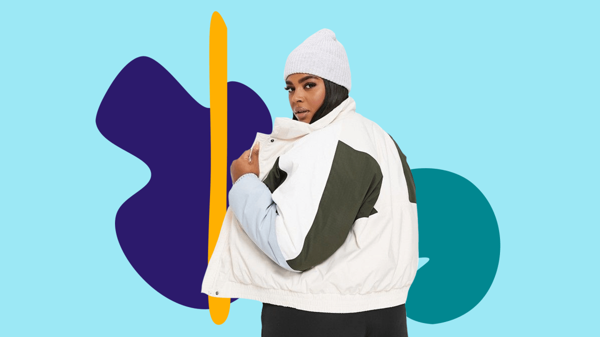 A model wearing a plus-size ski jacket in white and olive green.