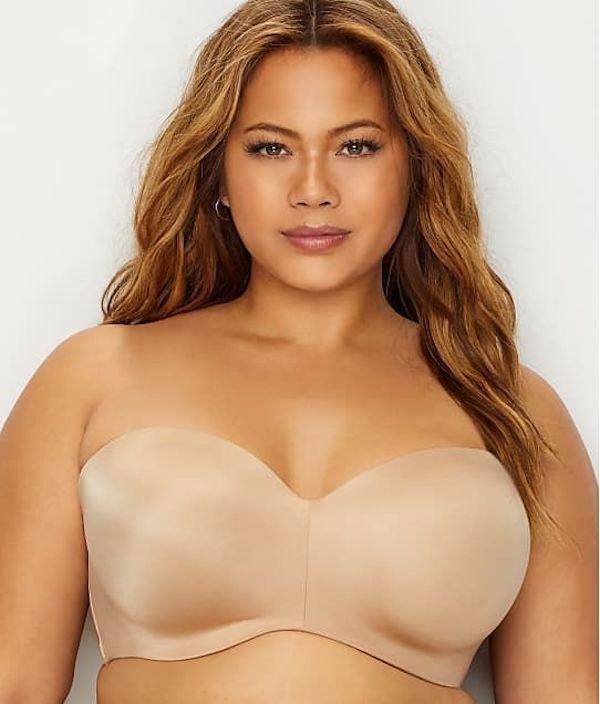 A model wearing a plus-size strapless bra in tan.