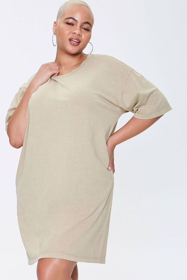 A model wearing a plus-size t-shirt dress in cream.
