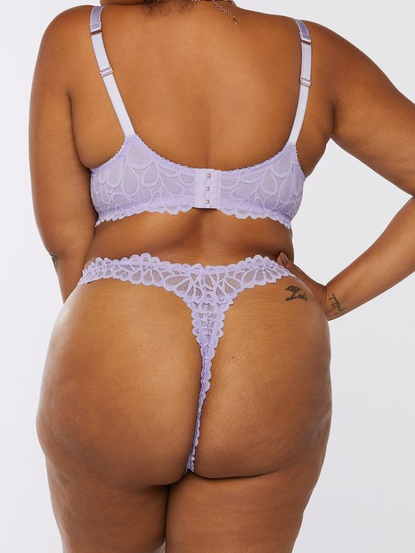 A model wearing a plus-size thong in lavender.
