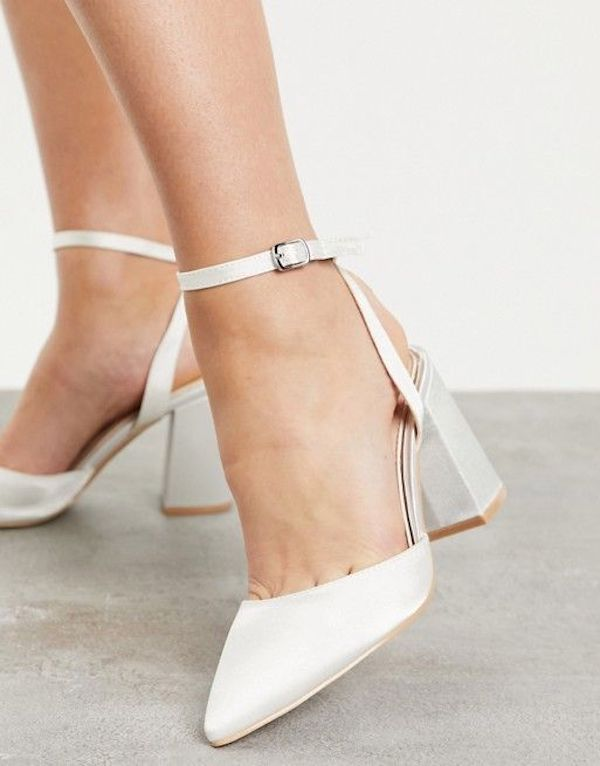 A pair of wide-fit block heels in white.