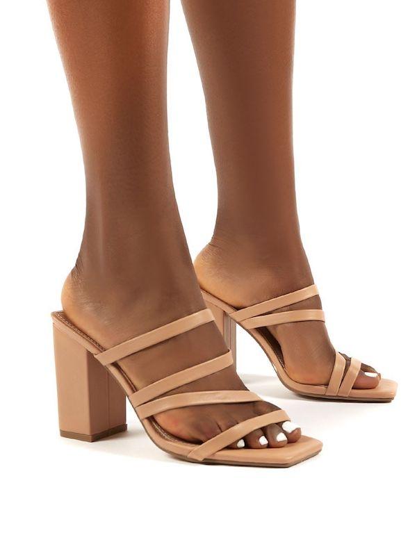 A pair of wide-fit block heels in beige.