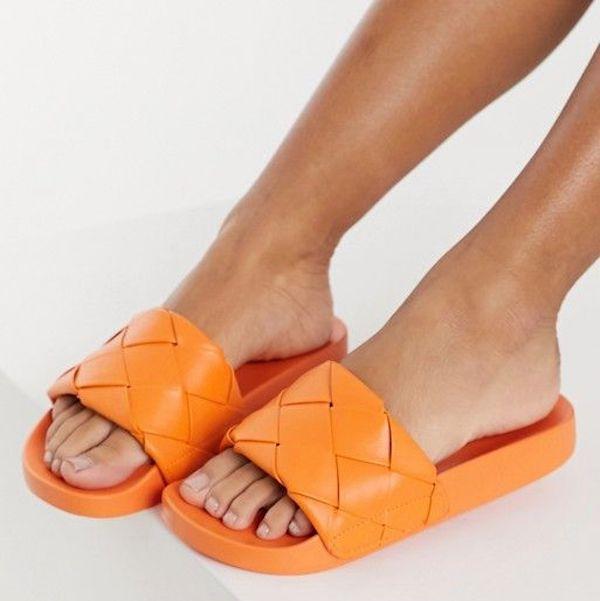 Wide-fit slide sandals in orange.