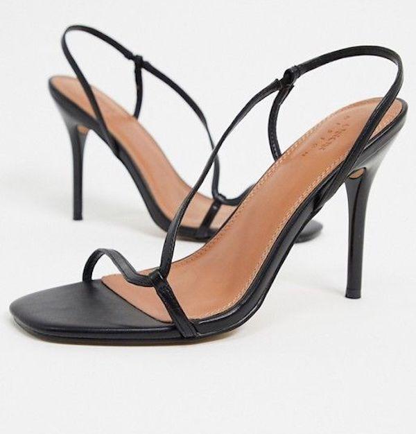 Wide-fit heeled sandals in black.