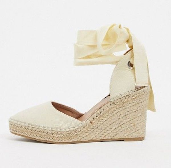A pair of wide-fit wedges in cream.