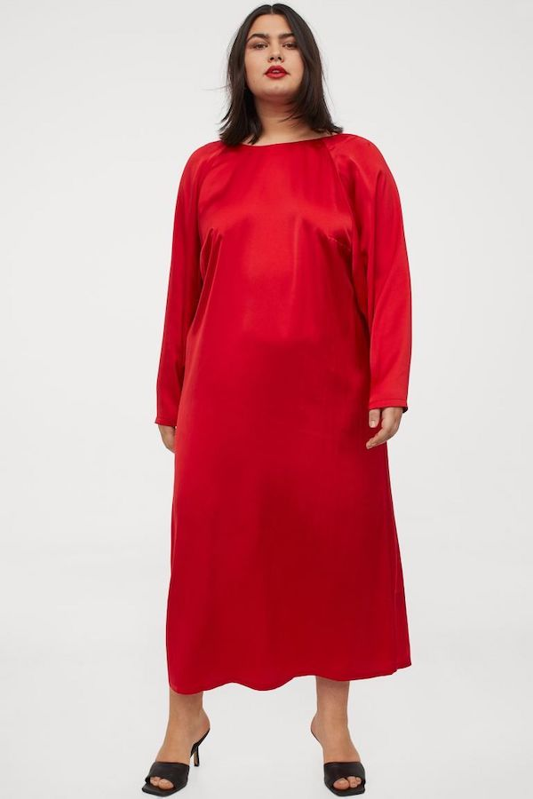 A model wearing a plus-size maxi dress in red.
