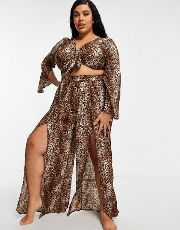 A model wearing plus-size beach pants in leopard print.