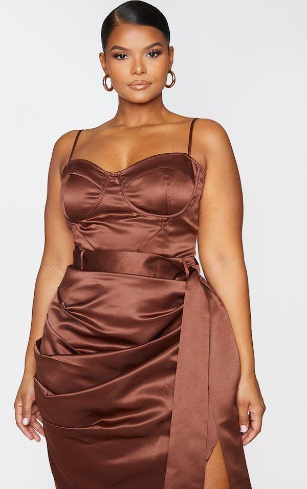A model wearing a plus-size bustier top in brown.