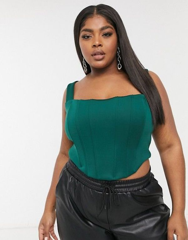 A model wearing a plus-size bustier top in green.