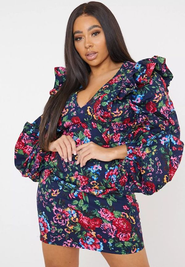 A model wearing a plus-size mini dress in floral.