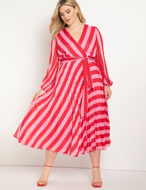 A model wearing a plus-size midi dress in red and pink stripe.