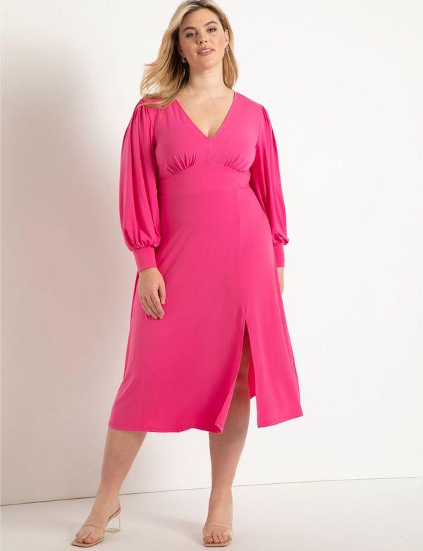 A model wearing a plus-size midi dress in pink.