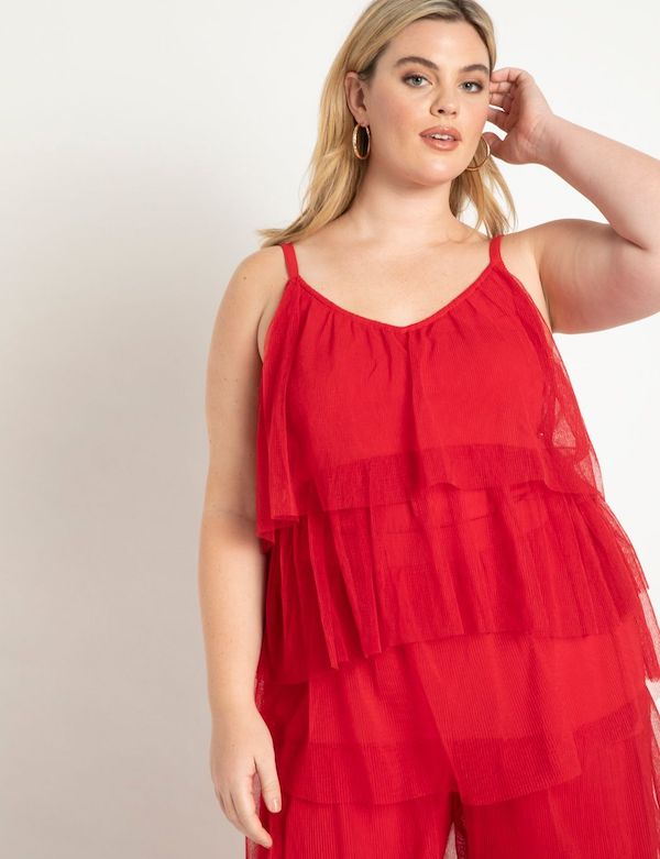 A model wearing a plus-size top in red.