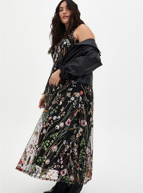 A model wearing a plus-size floral maxi dress.