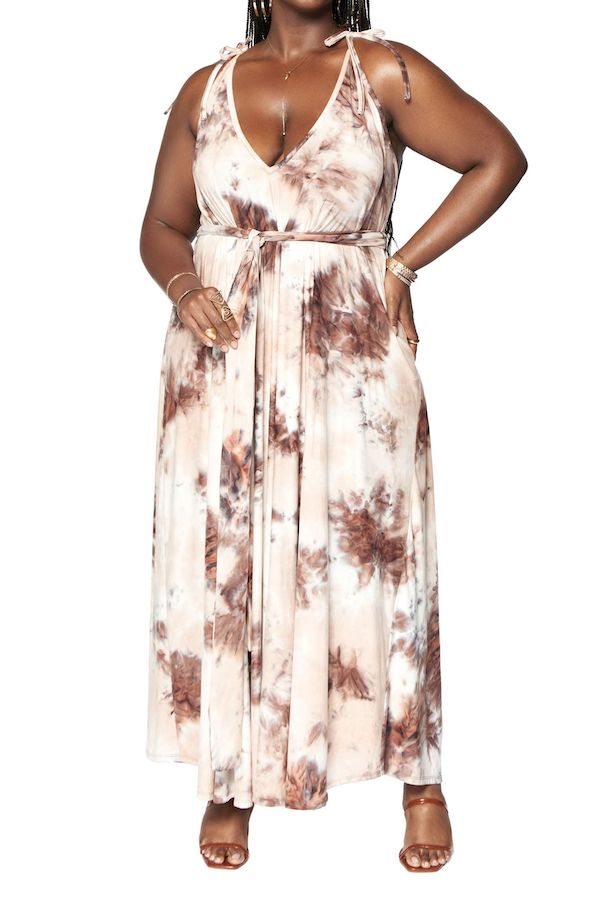 A model wearing a plus-size halter dress in brown tie-dye.