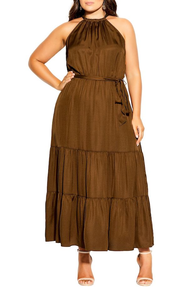 A model wearing a plus-size halter dress in brown.