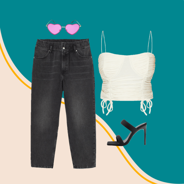 Plus-size black jeans, cream cami, black heels, and pink heart-shaped sunglasses.