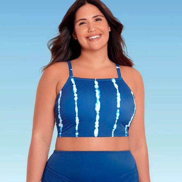 A model wearing a plus-size high-neck swimsuit in blue tie-dye.