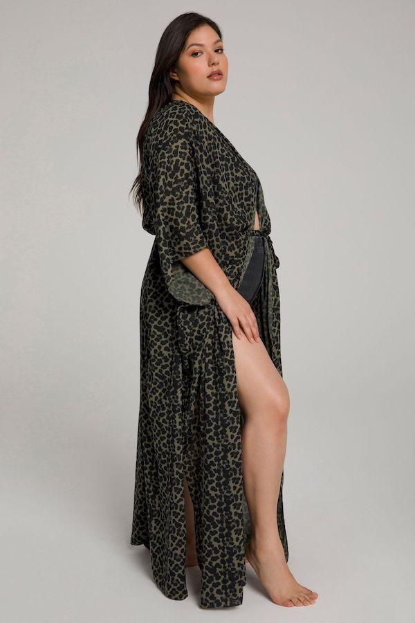 A model wearing a plus-size kimono swim cover-up.