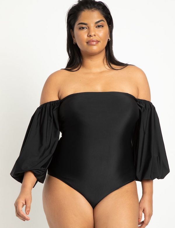 A model wearing a plus-size off-the-shoulder swimsuit.