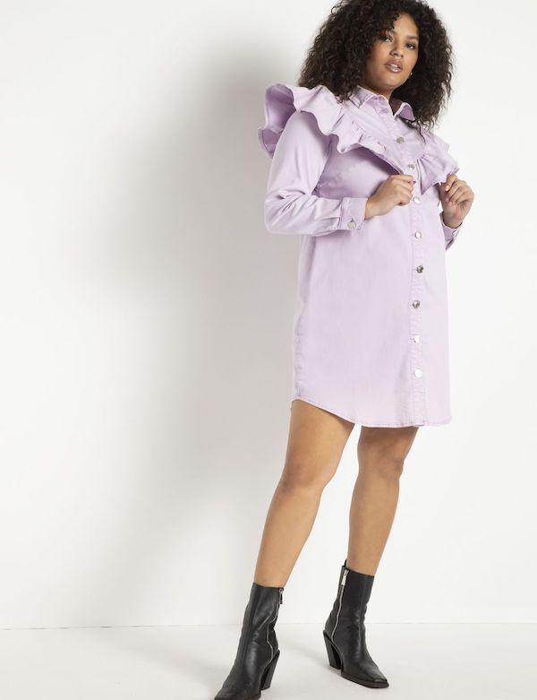 A model wearing a plus-size ruffle dress in purple.