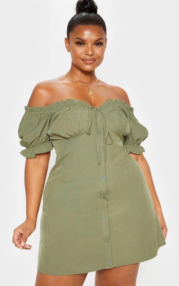 A model wearing a plus-size sexy summer dress.
