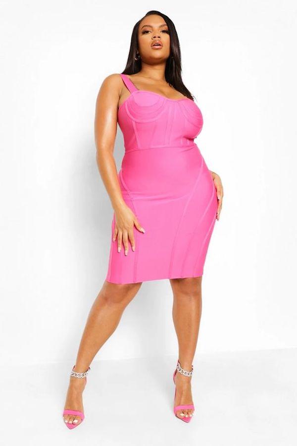 A model wearing a plus-size corset dress.