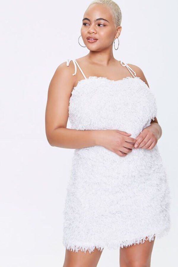 A model wearing a plus-size feathered dress.