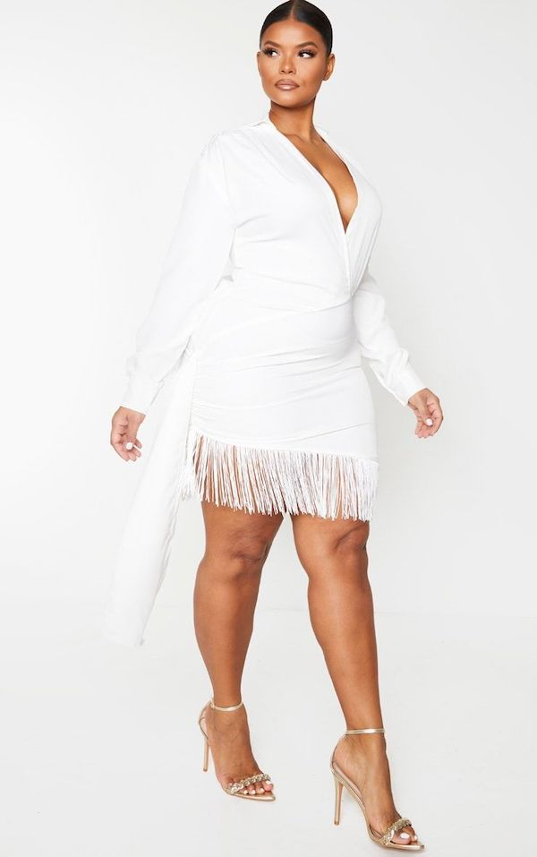 A model wearing a plus-size fringe dress.